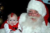 St. Nick visits with a baby